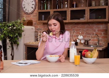 Eat Good, Feel Good, Look Good! Good-looking Attractive Lady Sitting In The Kitchen And Having For B
