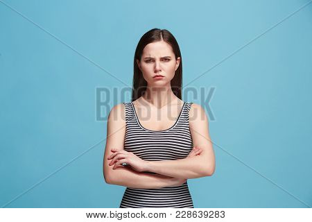 Serious Woman Standing, Looking At Camera Isolated On Trendy Blue Studio Background. Beautiful, Youn