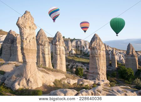 Colorful Hot Air Balloons Flying Over Gorcundere Valley In Cappadocia, Anatolia, Turkey