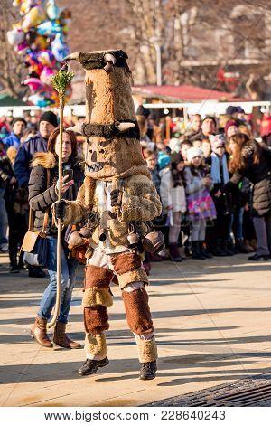 Pernik, Bulgaria - January 26, 2018: Dancer Dressed As Kuker In Fur Costume Dances And Jumps To Ring