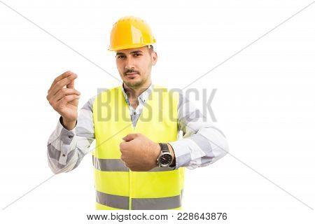 Engineer Or Architect Showing Watch And Money Gesture.