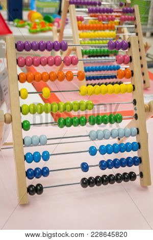 Children's Abacus On The Table. Children's Room, Game, Training