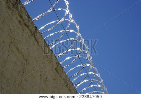 Barbed Wire Protects A Residence From Intruders