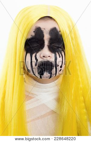 Portrait Of Young Woman With Scary Halloween Makeup Over White Background
