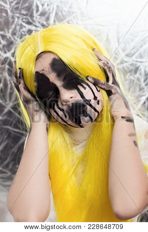 Portrait Of Young Woman With Yellow Hair With Scary Halloween Makeup