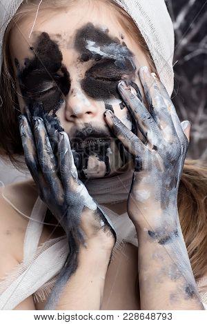 Teenager Girl With Mummy Bandages On Halloween