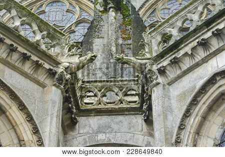 Two Gargoyles On The Walls Of A Cathedral Of Saint Julien At Le Mans, France