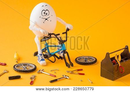 Funny Insane Egg Repairing Bicycle With Various Tools.