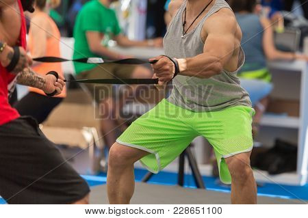 Rimini, Italy - June 2017: Fitness And Sport: People Exercising With Elastic Lace.