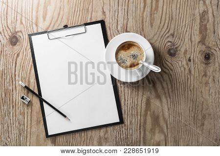 Blank Letterhead, Clipboard, Pencil, Sharpener And Coffee Cup On Wooden Background. Responsive Desig