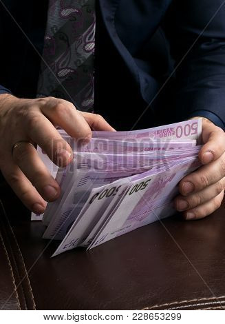 Man Counting Money Cash