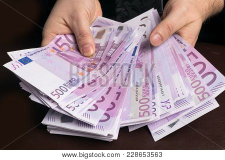 Man In Men's Suits.bribe And Corruption With Euro Banknotes.