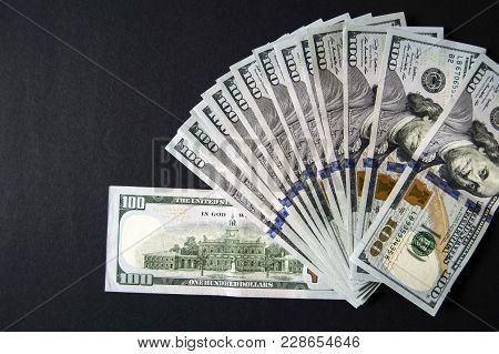 Old 100 Dollars, Old 100 Usa Dollars Standing On Black Ground,