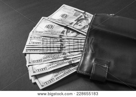 Usd 100-hundred- Dollars, Many Standing On A Black Background Usd Dollars