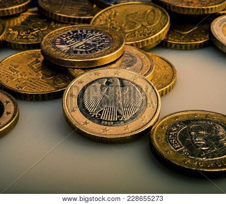 Group Of Coins Worth One Euro Lies On The Table. Euro Money.  Currency Of The European Union.