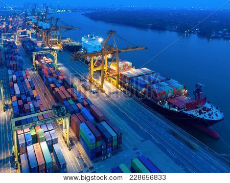 Aerial View Of Containers Yard In Port Congestion With Ship Vessels Are Loading And Discharging Oper