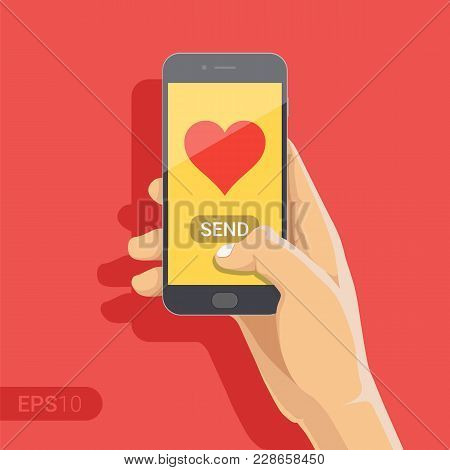 Sending Love Message Concept. Hand Holding Phone With Heart, Send Button On The Screen. Finger Touch