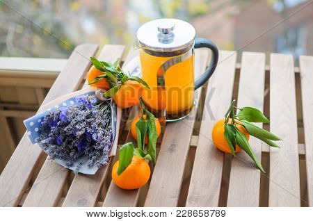 Close Up Beautiful Natural Stillife Of Several Fresh Tangerines, Vitamin Drink In Kettle And Violet
