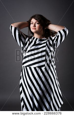 Plus Size Fashion Model In Striped Dress, Fat Woman On Gray Studio Background, Overweight Female Bod