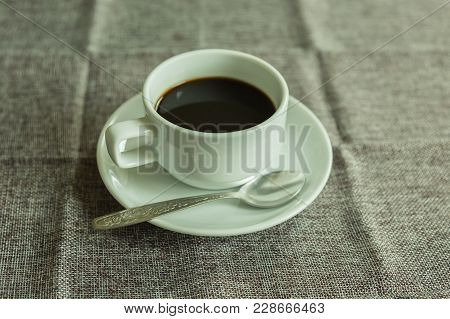 Coffee Cup On The Desk On Wood Background.