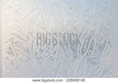 Drawing On Glass In A Frost . Frosty Picture On The Window. Frost Pattern