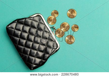 Purse For Coins.wallet For Change. A Leather Purse, Wallet On A Turquoise Background. Trend Colors.t