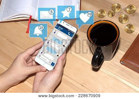 Girl Holding Smartphone With Chat Interface And Icons From Social Media. Social Media Concept. Chat