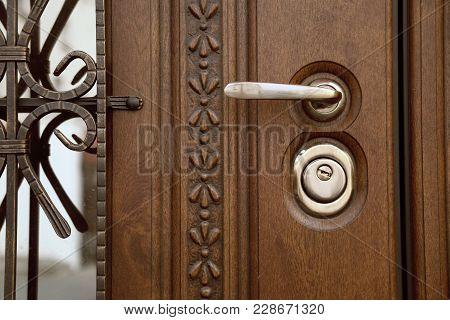 Door Handle. Wooden Door And Beautiful Handle With Lock