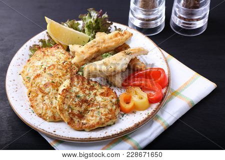 Fried Fish With Zuccini Pancakes . Seafood With Vegetables