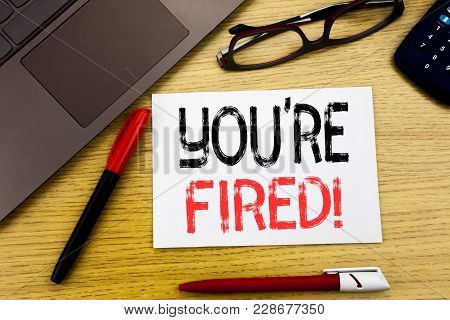 Conceptual Hand Writing Text Showing You Are Fired. Business Concept For Unemployed Or Discharge Wri