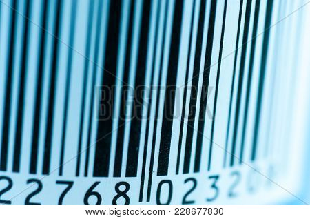 Scratched Paper Bar Code Close Up Macro Shot On Blue Tone .