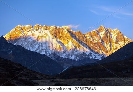 Evening Sunset Red Colored View Of Everest And Lhotse With Beautiful Clouds, Khumbu Valley, Solukhum
