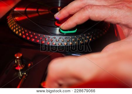 Male Hands Playing Dj With Toy Turntable Of Console On A Party