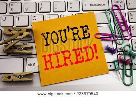Writing Text Showing You Are Hired. Business Concept For Hiring Employee Worker Written On Sticky Pa