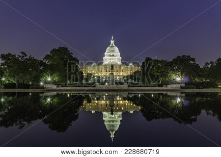 The United States Capitol Building, Seen From Reflection Pool On Dusk. Washington Dc, Usa.