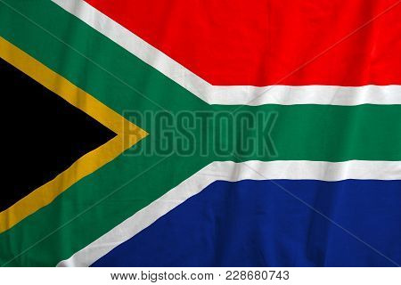 Waving Colorful National Flag Of South Africa. Fabric Texture Of The Flag Of South Africa