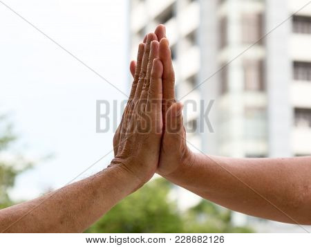 Close Up Of Hand Clap Of Men Giving Hi Five Hand