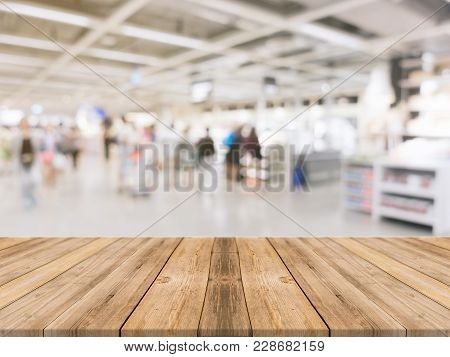Wooden Board Empty Table Blurred Shopping Mall Background. Perspective Brown Wooden Table Blur In De