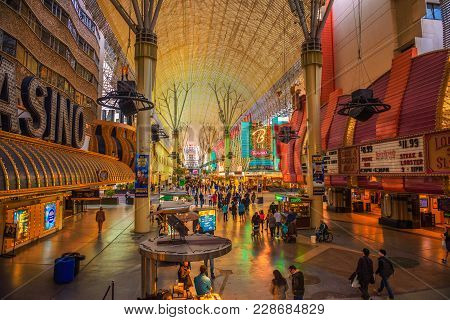 Las Vegas, Usa - January 3, 2018 : Fremont Street With Many Neon Lights And Tourists In Downtown Las