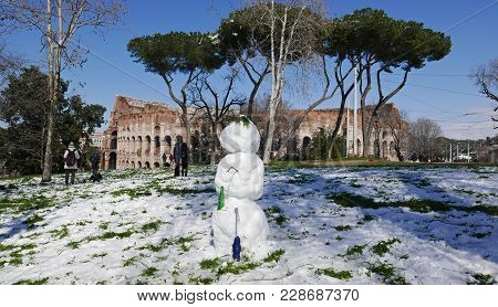 Rome, Italy -  February 26, 2018: Snowman In Front Of The Colosseum , Romans Enjoy The First Snow In