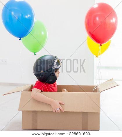 Boy fantasizing him self flying