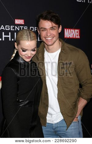 LOS ANGELES - FEB 24:  Dove Cameron, Thomas Doherty at