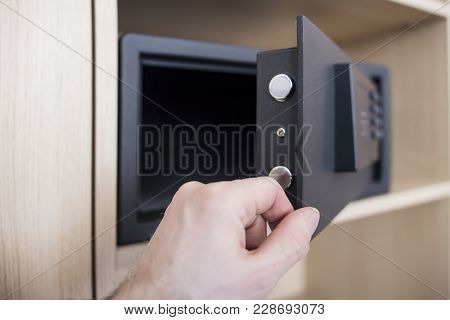 Open Safe Door With Electronic Lock Close Up. Keep Money And Jewelry At Home. Man's Hand And Safe In