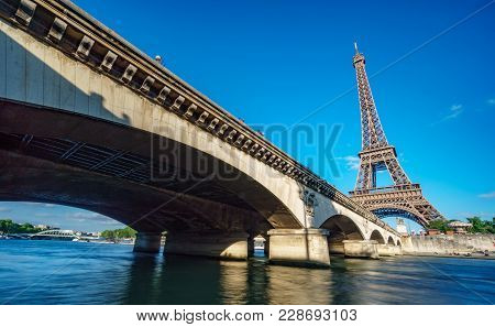 Wide Angle View Of The Eiffel Tower, Bridge And Seine River, Long Exposure In Paris, France