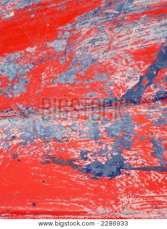 Abstract Close Up Of Red Paint On A Boat Hull.