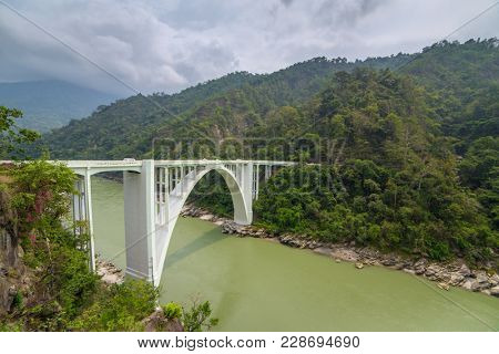 The Coronation Bridge, also known as the Sevoke Bridge, in Darjeeling, West Bengal, India. It spans across the Teesta River, connecting the districts of Darjeeling and Jalpaiguri.