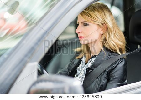 Woman driving her car
