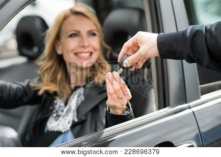 Woman taking car keys from a man