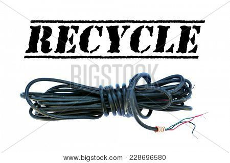 Copper Wire Scrap isolated on white with room for your text. Plastic coated electrical copper wire on white.