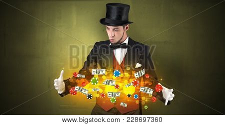 Young illusionist in tails hold between hands gambling staffs with super power